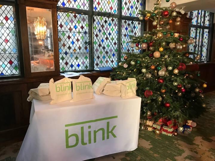 Blink branded items next to Xmas tree