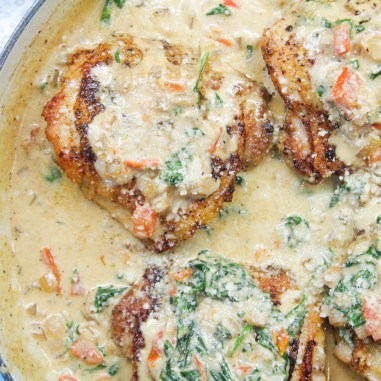 Creamy Tuscan Chicken on a bed of Angel Hair