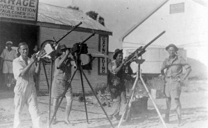 local volunteers pose with machine guns