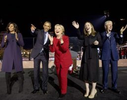 On the eve of the election, an exuberant group of Democratic power players celebrates following a massive rally in Philadelphia. From left to right: Michelle and Barack Obama; Hillary, Chelsea, and Bill Clinton