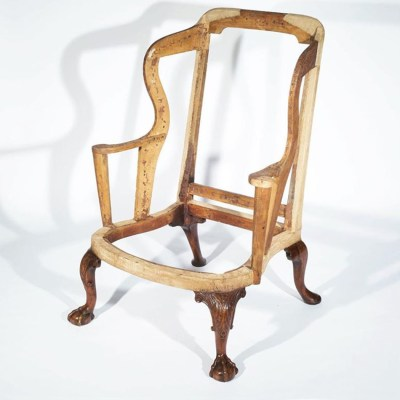 George I walnut wing arm chair covered with 18th century needle-work