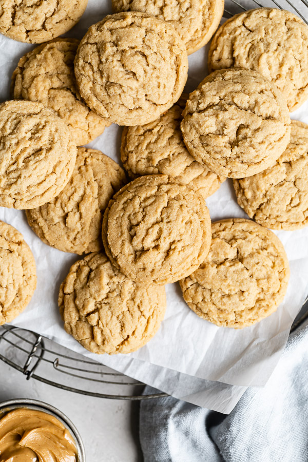 group of peanut butter cookies on baking tray with parchment paper