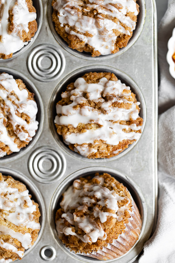 close-up of peach streusel muffin in muffin pan