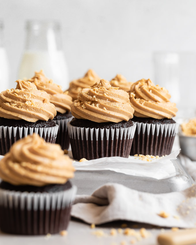 dark chocolate cupcakes with peanut butter frosting on platter