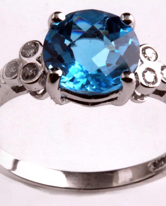 Blue Dopaz/ Diamond Rng