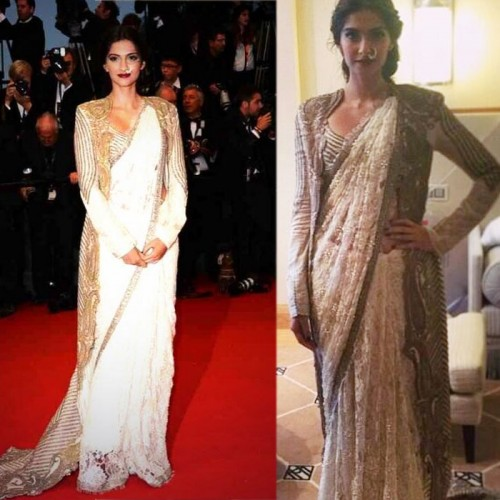 Sonam Kapoor pairs her Annamika Khanna sari with an embroidered jacket. She pulls the the whole outfit together with her mother's nathni.