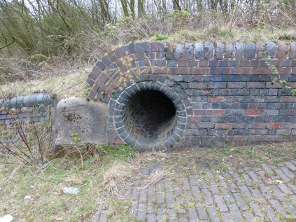 "I chose to enter the right hand culvert. About 24"" diameter. Don't do it kids - it's messy, uncomfortable and dangerous."