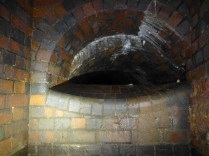On the far side of the gate chamber is a semicircular culvert, too small to enter, the brickwork forming a perfect lip.