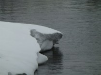 Even the main lake has curious, gravity-defying overhanging ice.