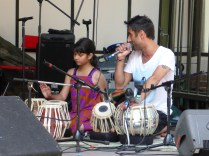 Dalbir sings Jessie J whilst giving tabla pro tips to a young apprentice