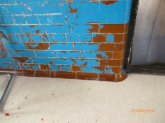The original brown wall tiling has survived, better than the modern paintwork. Image courtesy David Evans.