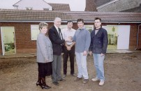 Keys of renovated building being handed over by the builders to John Sylvester with fellow directors Pauline Jacks and Brian Bishop looking on. Image very kindly supplied by John Sylvester.