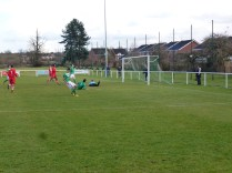 An attack on Brocton's goal ,and a near-miss.