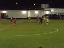 Walsall Wood starting an attacking move from the halfway line, with Basford in rapid retreat