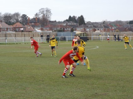 Anthony Juxon out-manoeuvring a Basford defender