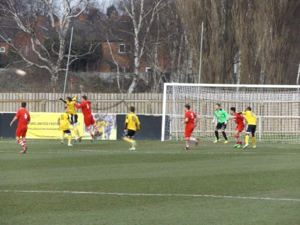 An attacking move by Basford with Walsall Wood player challenging in incoming ball