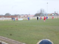 AFC Wulfrunians attacking, and Walsall Wood closely marking their opponents.