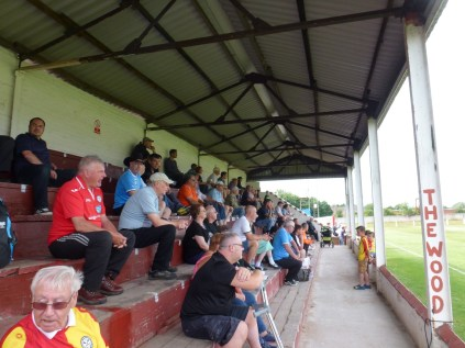 Some of the visiting supporters, enjoying the match