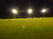 Floodlit sporting soccer, enjoyed by players and spectators alike.