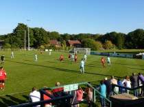 Sporting soccer match played in early autumn sunshine.