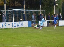 Wood's third goal rockets past the defending 'keeper