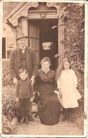 Great grandfather and grandmother with my aunty Peggy and uncle Clarence taken outside Mile Oak Farm I guess from the children about 1916.