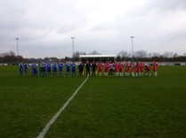 A biting cold wind but two teams full of heart prepare for the start of the match