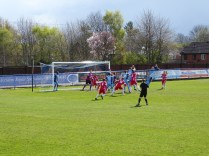 Long Eaton defend this early corner kick well.