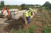The Amey volunteer workforce concreting the towpath wall over the Cranebrook culvert at Summerhill
