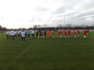 Customary handshake before the match, followed by a minutes silent tribute in memory of Brian Bottomer, well-respected former Walsall Wood player
