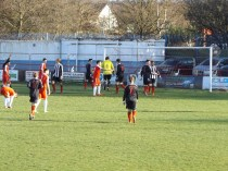 One of many corner kicks where players had to contend with the fresh wind and low level sunshine