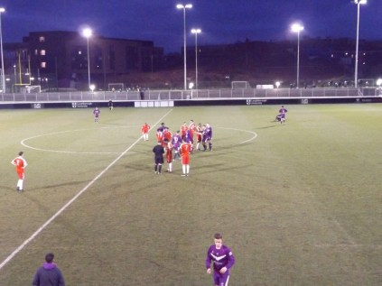 Players engage in traditi0onal socialising and bonding moment as the ref takes note. A frequent today.