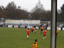 The Wood reply and surge forward to attack the Rocester goal. Smashing football!