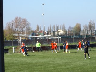 """The Wood adopt a """"chalet"""" defence position as Long Eaton prepare to receive a high lobbed ball."""