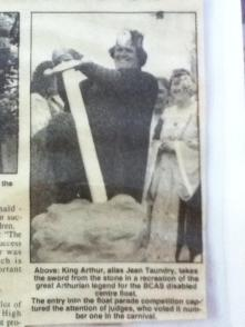 1996: Newspaper clipping showing Jean Taundry on the float