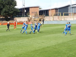 The celebratory delight following the goal by Whitchurch. How would the Wood respond?