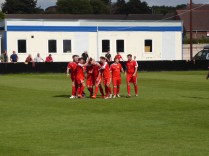 Second goal celebrations and the scorer has his hair re-styled by kind team-mates.. en masse