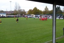 Hari ruffling time as the Wood celebrate! Holbeach players stand, hands on hips. What could they do to respond, if anything.