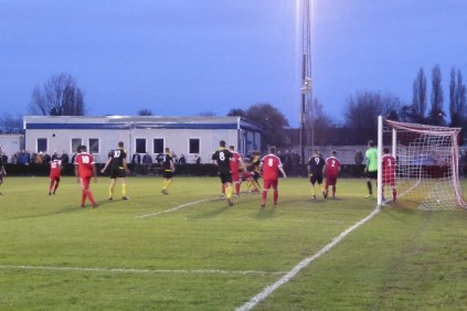 Holbeach throw everything in to scoring a goal, as home supporters clench their plastic beer glasses and teeth.