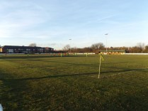 Clear sky, low-level winter sunshine and the appeal of a soccer match in the refreshing clean air.