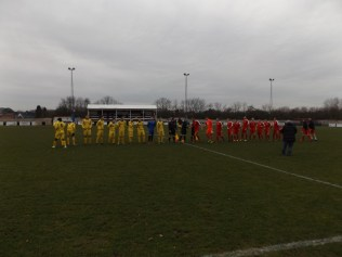 Walsall Wood welcome Stafford who wore bright yellow. A cold, bleak Boxing Day afternoon where supporters tried hard to focus on the game. Such was the pace of this cracking game today.