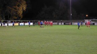 The Wood celebrate scoring the first goal and hug to keep warm