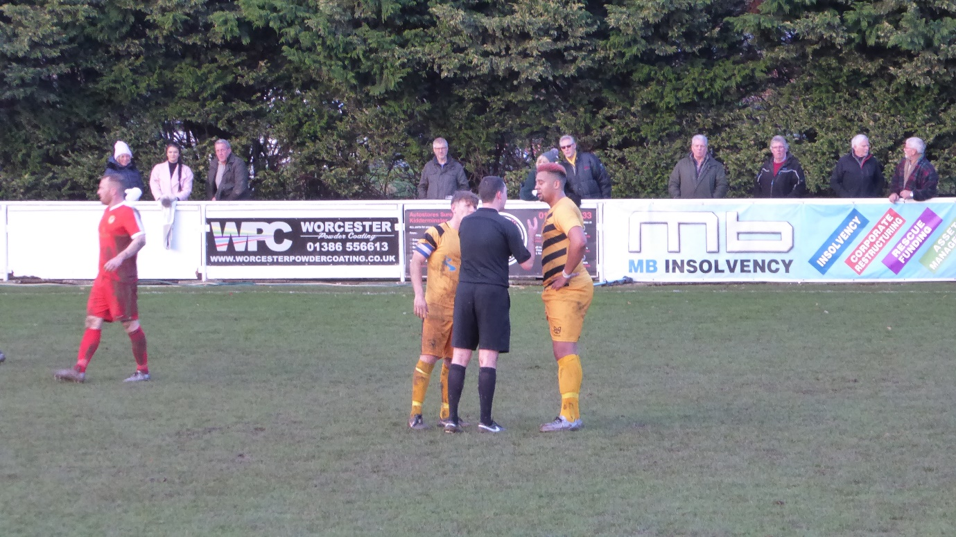 "The referee had a word with the tallest Stourport player after quite a while in the first half, watched closely by the captain, himself in need of a ""word"", I felt. This was to come, after a long while."