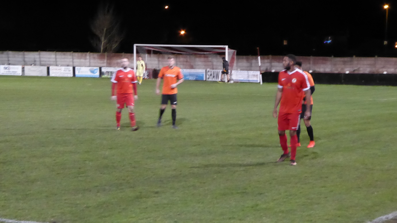 Second half and a ghostly black figure creeps past in the distance, un-noticed by players.