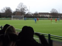 Lichfield keeper lies prone and completely trounced by this well- worked goal to the Wood. First half