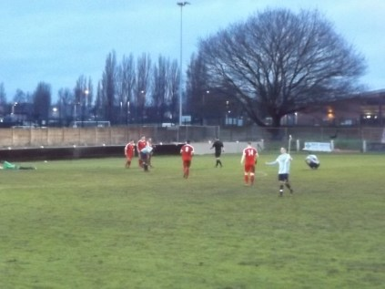Second half. Goal. Winter non-league soccer at the Theatre of Dreams. Players now have dirty kneecaps and mud-caked shorts to match . They all look tired, but all have visibly enjoyed this contest today.