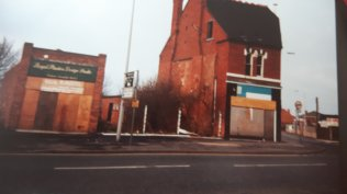 The old Co-op before demolition. Image posted by Joy Spears.