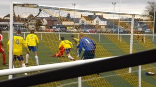 Later in the first half and the Wood s attack is again thwarted by the..erm..spirited play of the lads in yellow.
