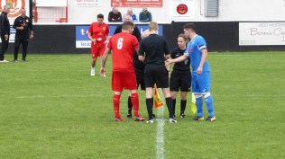 Customary handshake before the start of a competitive game of local soccer , Black Country style