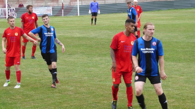 Later in the first half and one Wood player sports a head bandage now. An Ilkeston player had previously left the field to receive attention.